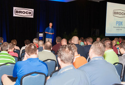 Doug Niemeyer, President and Chief Operating Officer of CTB Inc. and General Manager of Brock Grain Systems, leads the opening general session for the company's five-day sales information and training meeting held in late January. Over 500 people representing 120 Brock dealerships for Brock Grain Systems attended the gathering in Montego Bay, Jamaica. The periodically held meeting gives dealers the opportunity to build their skills in supporting and advising customers in selecting the best grain systems to meet their grain storage, handling, drying and conditioning needs.